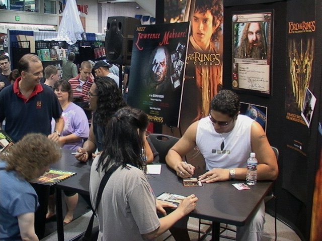 Sala Baker Signs a Decipher Card at ComicCon 2002 - 640x480, 98kB