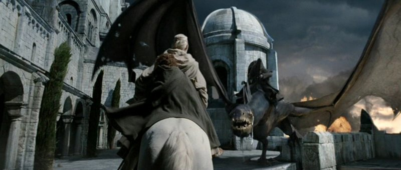 Gandalf and Pippin, riding on Shadowfax, stand off against a Nazgul (possibly the Witch King) in Minas Tirith.