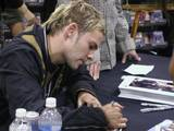 Dom signs an autograph. - (800x600, 97kB)