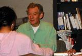Ian McKellen smiling converses with fan. - (504x352, 33kB)