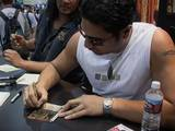 Sala Baker Signs a Decipher Card at ComicCon 2002 - (640x480, 98kB)