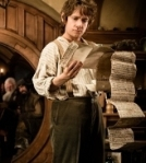 Bilbo reads the contract