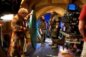 Peter Jackson talks to Graham McTavish while Martin Freeman, dressed as Bilbo Baggins, looks on.