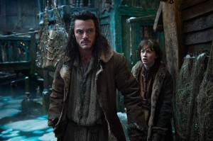 Luke Evans as Bard The Bowman and John Bell as his son Bain.