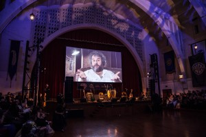 Peter Jackson sends a video message to partygoers.