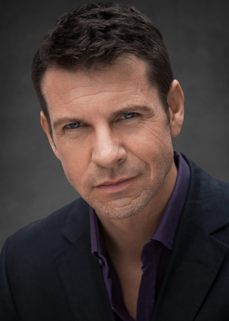 Headshot of actor Lloyd Owen