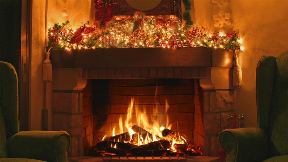 A roaring log fire in a cosy hearth, the mantelpiece decked with garland and lights