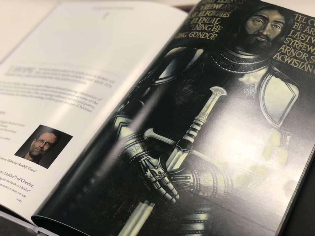 An inside image from the book, showing an icon painting of Elessar in armour, with Anduril in his hands