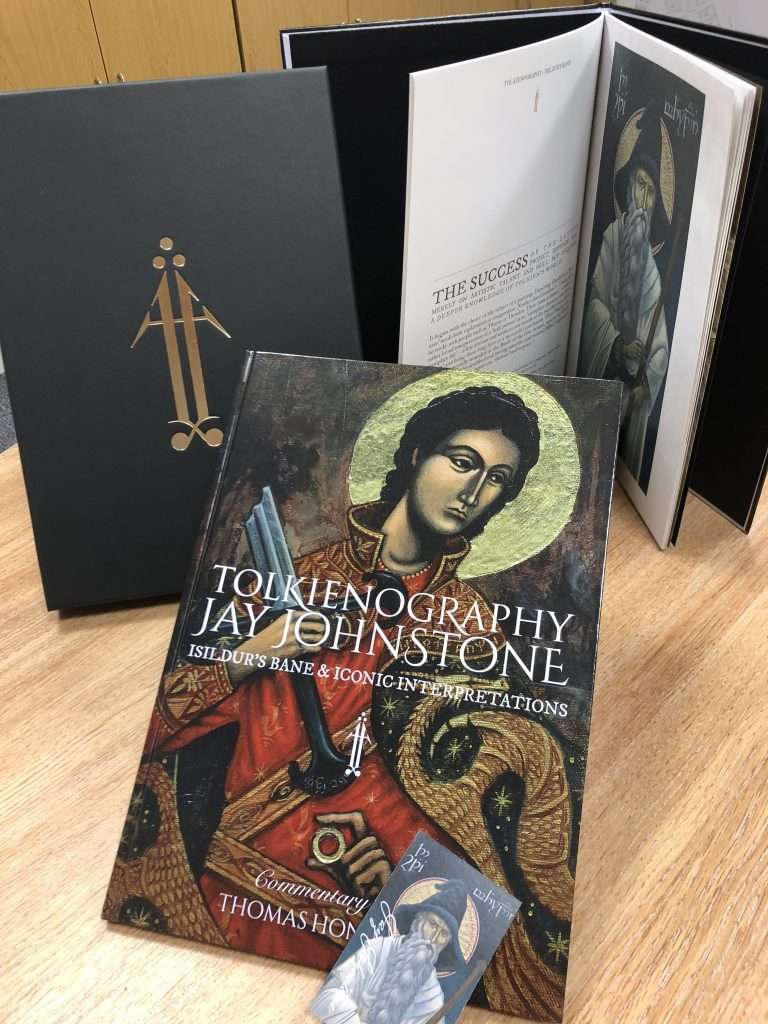 The cover and an inside glimpse of Jay Johnstone's beautiful book, showing Tolkien characters painted in the style of iconography. Also shown is the black (with gold logo) slip cover the book comes in.