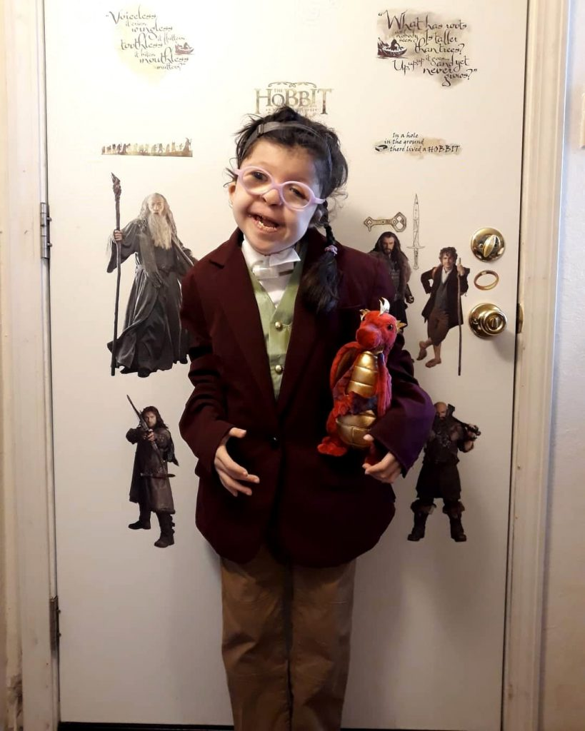 Fan Tina Castro's daughter dressed as an adorable Bilbo, complete with a soft toy Smaug.