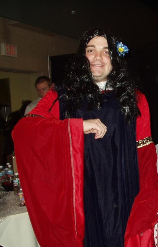 TORn founder Calisuri in a cosplay of Arwen's blue and red gown; with a lovely wig, and a flower behind his ear!
