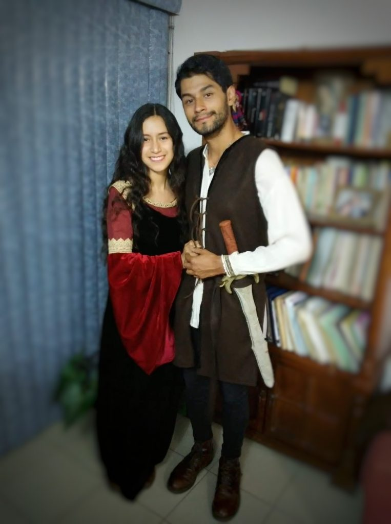 Fan Nadia and her boyfriend are wearing cosplay as Arwen in the blood red and blue dress, and as Aragorn in his leather jerkin.