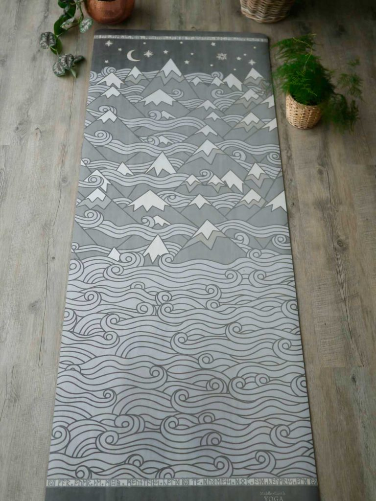 Photography of Middle-earth Yoga's 'Misty Mountains' yoga mat: a beautiful design in swirling grey tones, showing a stylised mountain range, with the moon and stars above.