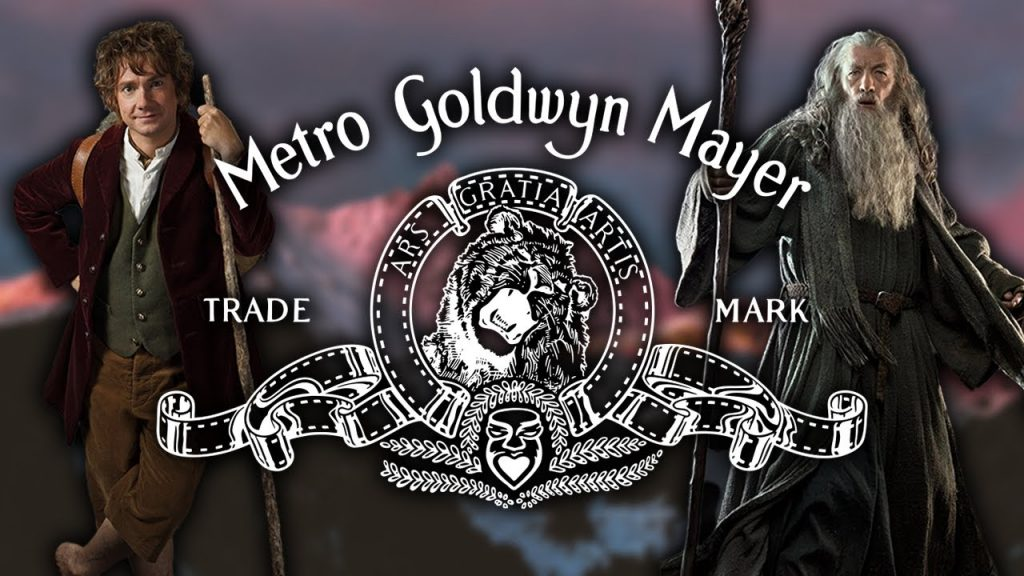 MGM's famous roaring lion trade mark is seen in front of Bilbo and Gandalf.