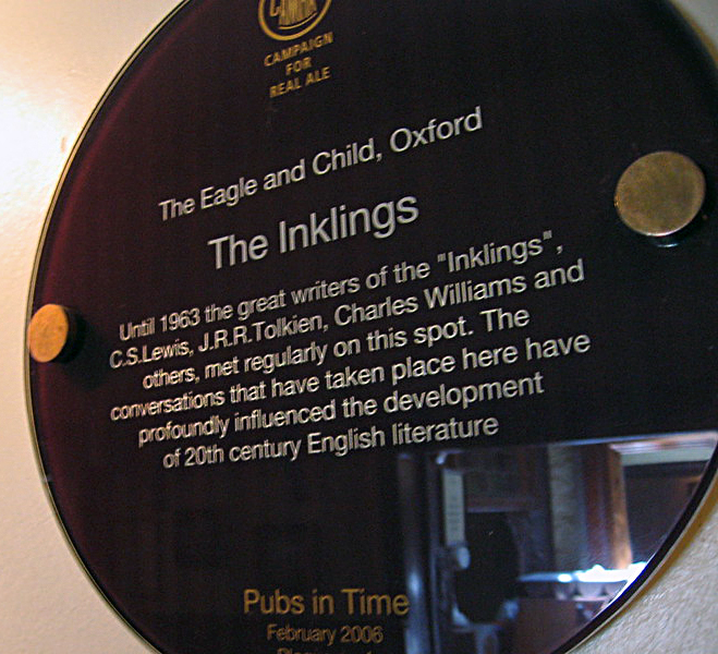 A plaque inside the Eagle and Child pub in Oxford, commemorating the place where The Inklings used to gather, It reads, 'Until 1963 the great writers of the 'Inklings', C.S. Lewis, J.R.R. Tolkien, Charles Williams and others, met regularly on this spot. The conversations that have taken place here have profoundly influenced the development of 20th century English literature.'