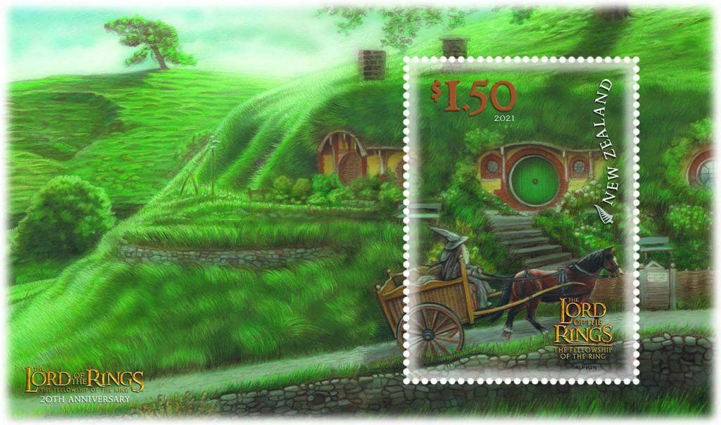 $1.50 stamp, showing an illustration of Gandalf in his cart, pulling up to the gate of Bag End - against a backdrop of a lush, green Hobbiton.