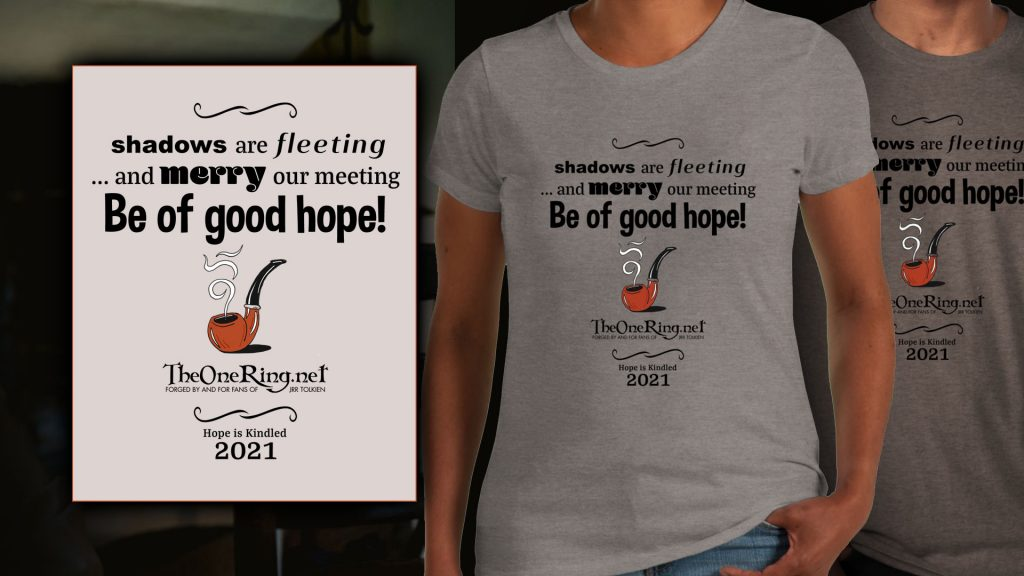 TORn's design, featuring quotations from Tolkien: 'Shadows are fleeing ... and merry our meeting. Be of good hope!' We see an image of a smoking pipe, and TORn's logo below. The bottom of the design features another quotation - 'Hope is Kindled' - and the date, 2021. The design is show on a pale grey t-shirt.